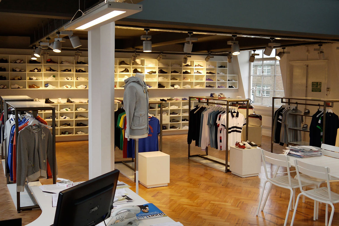 Le Coq Sportif interior integrates retail units and office space. Design of retail shop by Stanza Design