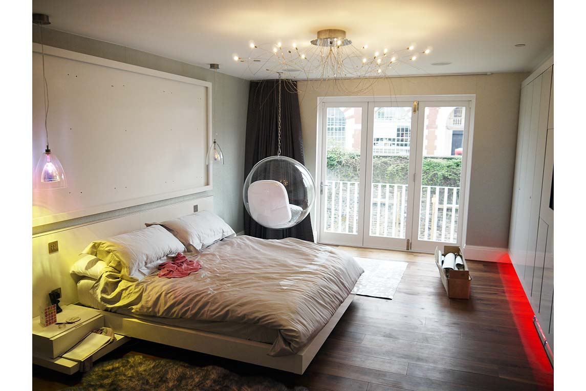 Master bedroom with hanging egg chair design in corner